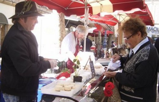 Goat's cheese seller at the market in Aix en Provence