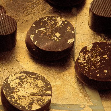 Gold-flecked Puyricard chocolates