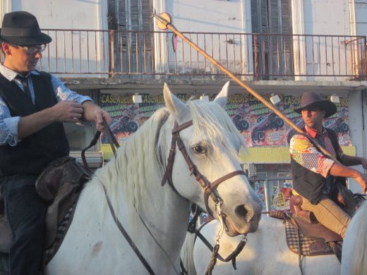 Camargue cowboys prepare to demonstrate their skills at the Arles Feria