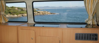 View of the sea from a Volkswagen T2 camper van
